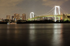 Tokyo at night. Tokyo Bay and Rainbow bridge, view from Odaiba, Tokyo, Japan. Rainbow Bridge connecting Tokyo city with Odaiba Island was completed in 1993 and Royalty Free Stock Photos