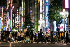 Tokyo night street scene near the Kabukicho district. Kabukicho is the densely-populated entertainment district near Shinjuku, Tokyo Stock Photography