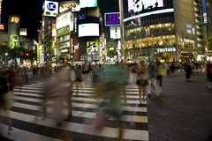 Japan, Tokyo, Night view of road crossing with pedestrian crossing royalty free stock images