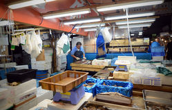TOKYO- NOV 26: Worker processing fish at the Tsukiji Wholesale S Royalty Free Stock Images