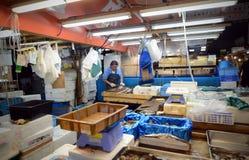 TOKYO- NOV 26: Worker processing fish at the Tsukiji Wholesale S Royalty Free Stock Images