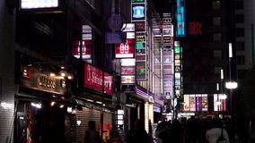 Billboards and neon signs in Shinjuku`s Kabuki-cho district also known as Sleepless Town in Tokyo, Japan stock video