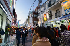 TOKYO - NOVEMBER 24 : People, mostly youngsters, walk through Takeshita street Stock Images