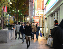 TOKYO - NOVEMBER 23: People visit street life in Shinjuku Royalty Free Stock Images