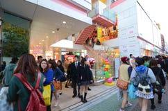 TOKYO - NOVEMBER 24 : People walk through Takeshita Dori near Ha Stock Photo