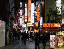 TOKYO - NOVEMBER 23: Street life in Shinjuku November 23 2013. Royalty Free Stock Photos