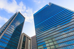 Tokyo office building bottom view in business district with Blue Stock Image