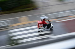 Tokyo rain pizza delivery Stock Photography