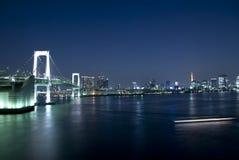 Tokyo Rainbow Bridge. Over bay waters with scenic night illumination Stock Images