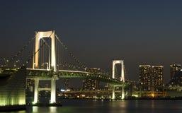 Tokyo Rainbow Bridge. Over bay waters with scenic night illumination Royalty Free Stock Photo