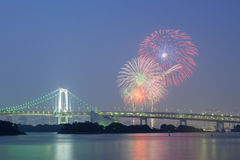 Tokyo rainbow bridge with beautiful firework Royalty Free Stock Photos