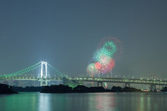Tokyo rainbow bridge with beautiful firework Royalty Free Stock Photo