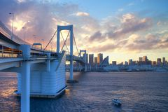 Tokyo Rainbow bridge. Over bay waters at dusk Royalty Free Stock Images