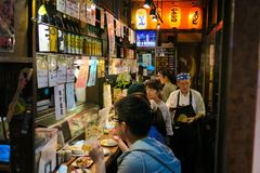Tokyo restaurant at night in Omoide Yokocho. The crowds pack into Omoide Yokocho day and night for a bite to eat Stock Photo