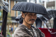 Tokyo rickshaw runner. Unidentified  rickshaw runner at Asakusa district in Tokyo, Japan. Rickshaws are believed to have been invented in Japan in the 1860s Royalty Free Stock Photo