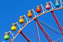 Tokyo's Ferris Whee. A multi coloured Tokyo's Ferris Wheel with blue sky background Royalty Free Stock Photos