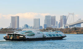 Tokyo sightseeing. Tourists admiring Tokyo skyline from Bay Trekker crossing Tokyo Bay Royalty Free Stock Photography
