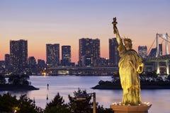 Tokyo skyline and Rainbow Bridge with cityscape at Odaiba Japan Stock Photography