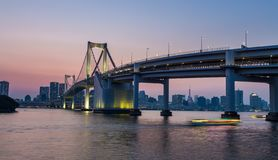 Tokyo skyline and rainbow bridge at night in Odaiba waterfront royalty free stock photography