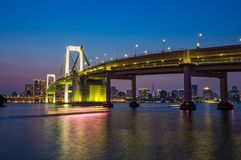 Tokyo skyline and rainbow bridge at night in Odaiba waterfront stock photos