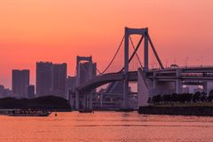 Tokyo skyline and rainbow bridge at sunset in Odaiba waterfront. stock photography