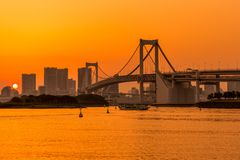 Tokyo skyline and rainbow bridge at sunset in Odaiba waterfront. stock image