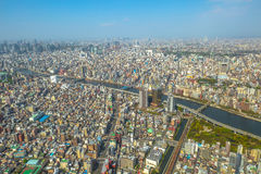 Tokyo skyline and Sumida River. Aerial view of Tokyo city skyline with Asahi Beer Hall, Asahi Flame o Golden Turd, Sumida River Bridges and Asakusa area from Stock Photos
