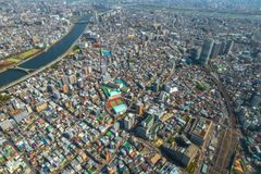 Tokyo skyline and Sumida River. Aerial View of Tokyo Skytree and Sumida River Bridges. View from the highest tower in Tokyo. Sumida District, Japan. Daytime Stock Photo