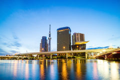 Tokyo skyline on the Sumida River. At twilight Royalty Free Stock Photos