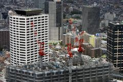 Tokyo Skyscraper Construction. Rooftop cranes at work constructing a new building in Tokyo, Japan.  Taken from Tokyo's Metropolitan Government Building in Royalty Free Stock Image