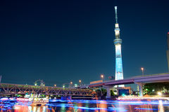Tokyo skytree blue illumination along Sumida river. Tokyo skytree at night with blue illumination beside the famous Sumida river, Tokyo, Japan Royalty Free Stock Images