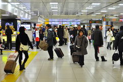 Tokyo station , japan. The picture shows busy travellers with their luggage in Tokyo train terminal during the new year holiday Stock Photography