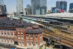 Tokyo station and JR trains,Tokyo. Tokyo, Japan - May 8, 2017: Antique Tokyo station and JR local and bullet trains, aka Shinkansen, parking at station with Royalty Free Stock Image