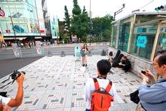 Tokyo :Street performer. Crowd watching performer in the streets in Harajuku, Tokyo Japan royalty free stock photos