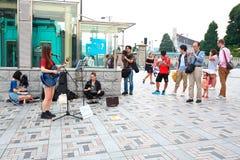 Tokyo :Street performer. Crowd watching performer in the streets in Harajuku, Tokyo Japan royalty free stock images