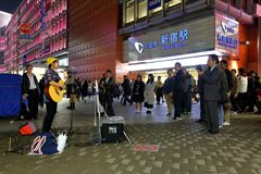 Tokyo :Street performer. A performer in the streets outside Shinjuku station, Tokyo Japan royalty free stock photography