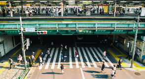 Tokyo - Street view with train platform, crosswalk and people at Nakano Station. Royalty Free Stock Photos