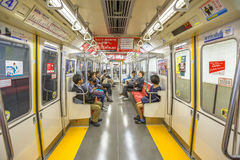Tokyo Subway interior. Tokyo, Japan - April 17, 2017: asian people commuter subway wagon interior. The Toei Oedo Line, a subway line in Tokyo. On maps and Royalty Free Stock Image