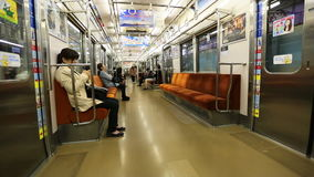 Tokyo Subway time lapse. Tokyo, Japan - April 17, 2017: time lapse of asian people subway wagon in Toei Oedo subway line in Tokyo. On maps and signboards, the stock video footage