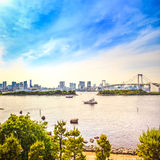 Tokyo sunset Skyline with Rainbow Bridge and bay from Odaiba. Japan Royalty Free Stock Photo
