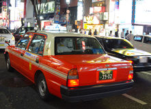 Tokyo Taxi. Taxi stuck in traffic in Shibuya, Tokyo, Japan. Taxi fares go up considerably at later hours Royalty Free Stock Photography