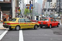 Tokyo taxi cabs. TOKYO, JAPAN - MAY 9, 2012: People ride taxi cabs in Tokyo, Japan. There are about 50,000 taxis in Tokyo,  the most populous metropolitan area Stock Images