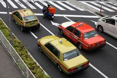 Tokyo taxi. TOKYO - MAY 9: People ride taxi cabs on May 9, 2012 in Tokyo, Japan. There are about 50,000 taxis in Tokyo,  the most populous metropolitan area in Stock Photo