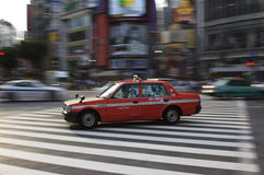 Tokyo taxi in Shibuya panned Stock Image