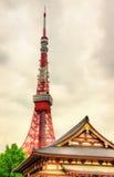 Tokyo Tower above Zojo-ji Temple Stock Image
