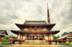 Tokyo Tower above Zojo-ji Temple Royalty Free Stock Photography