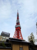 From the Tokyo Tower. Tokyo tower behind japan traditional house Stock Photos