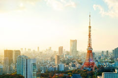 Tokyo tower, landmark of Japan, and panoramic modern city bird eye view with dramatic sunrise and morning sky Royalty Free Stock Images