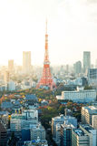 Tokyo tower, landmark of Japan, and panoramic modern city bird eye view with dramatic sunrise and morning sky Stock Photo