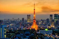 Tokyo tower light up at dusk. With twilight sky before sunset, Japan. Arial skyline cityscape view of famous landmark Royalty Free Stock Image